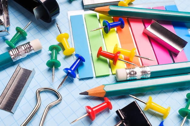 School and office stationery on a white sheet. the concept of education, office work, business, entrepreneurship. workplace freelancer. close up.