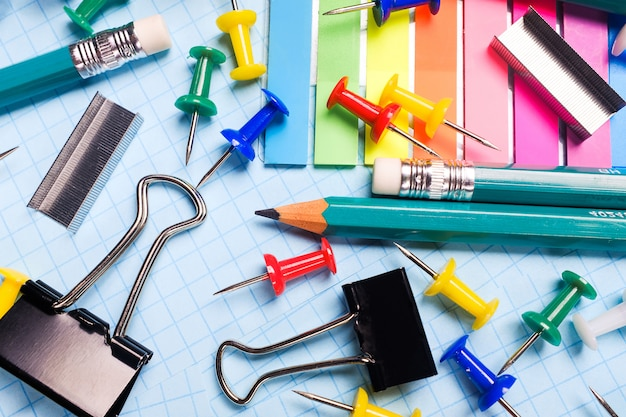 School and office stationery on a white sheet.