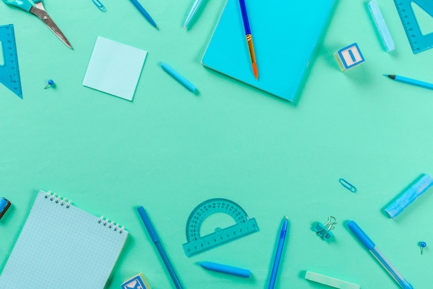 School and office supplies background in top view
