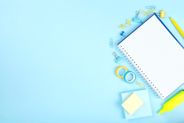 School office supplies on blue background