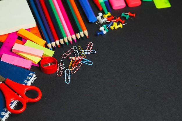 School and office supplies on dark background. top view with copy space