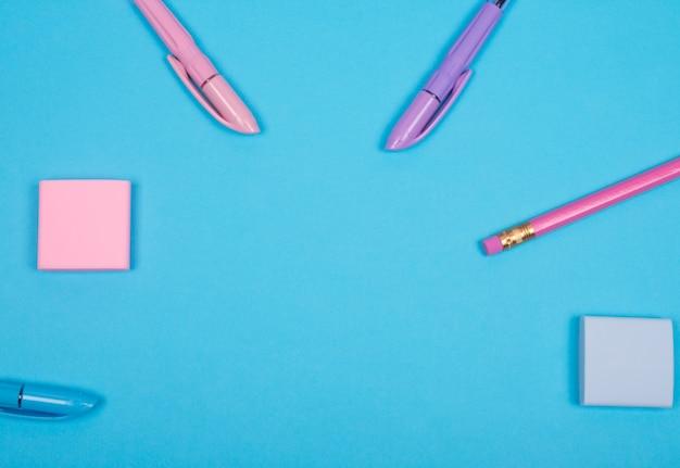 School or office supplies on light blue