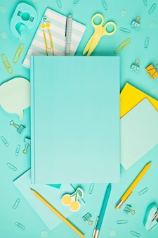 School and office supplies on pastel background
