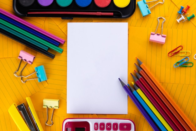 School office supplies stationery on a orange paper