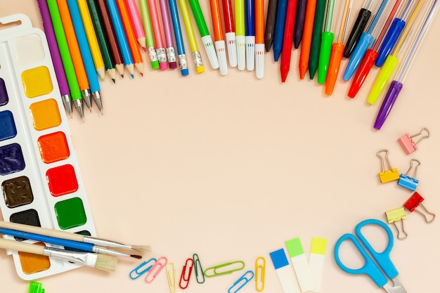 School and office supplies on table.