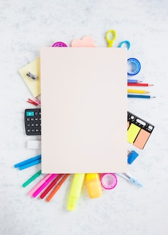 School and office supplies on textured background
