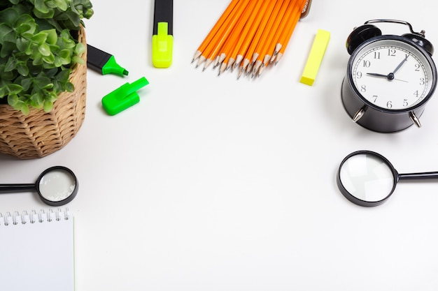 School and office supplies on white background