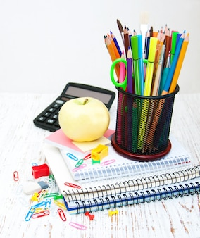 School office supplies on a white wooden table