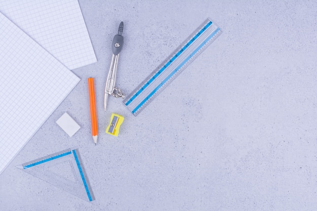 School or office tools with sticky notes on grey.