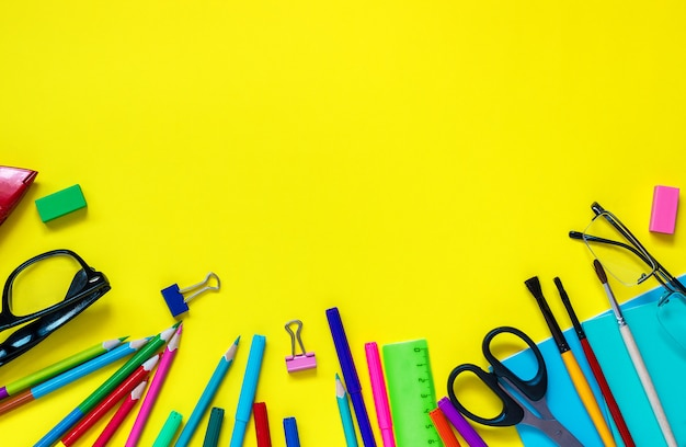 School pupil stationery glasses still-life on yellow background