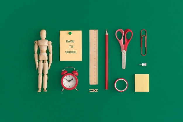 School stationery on a green background. top view with copy space. flat lay. back to school concept.