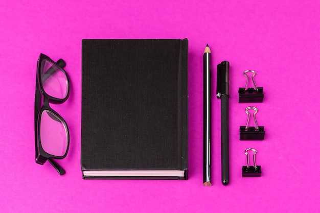 School stationery on a pink . back to school creative supplies