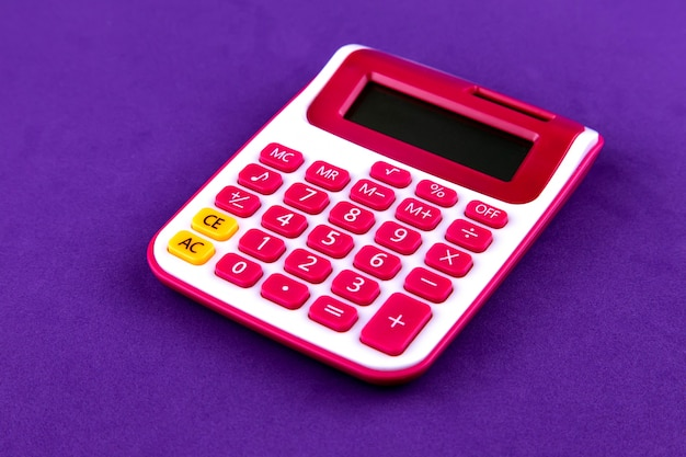 School stationery red calculator isolated on purple