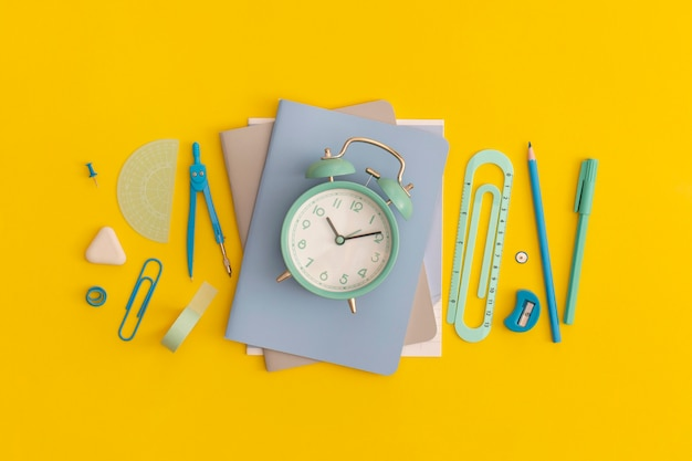 School stationery on a yellow backgroun top view with copy space flat lay back to school concept