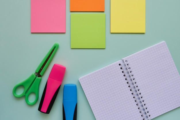 School subjects on a blue background. back to school concept. flat lay, copy space