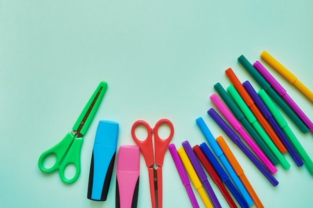 School subjects on a green background. back to school concept. flat lay, copy space