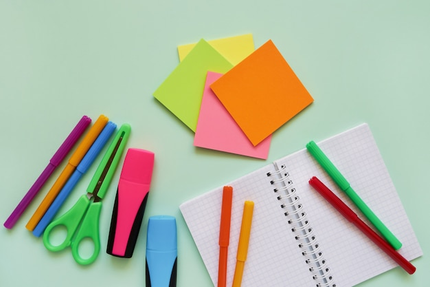 School subjects on green background. back to school concept. flat lay, copy space