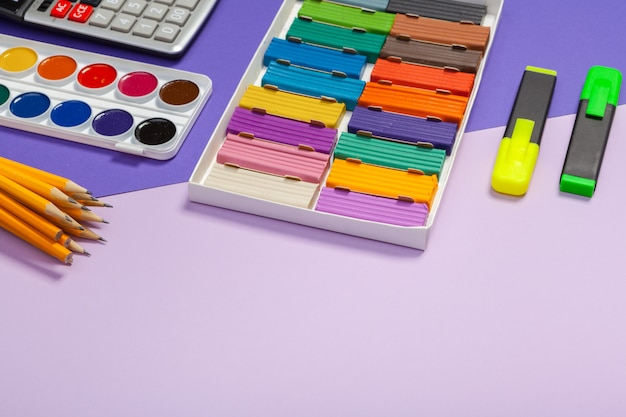 School supplies at abstract colorful texture