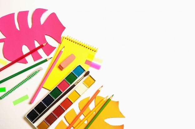 School supplies against white background.
