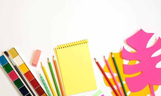 School supplies against white