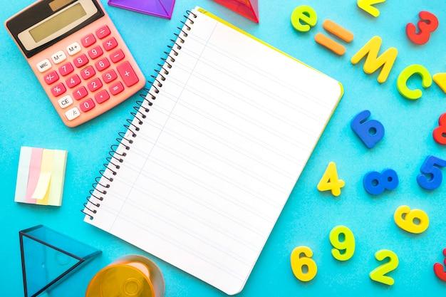 School supplies around notebook