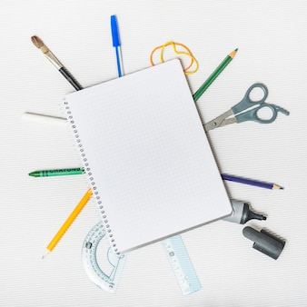School supplies around notepad