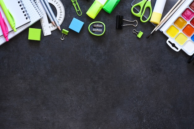School supplies on a black background. back to school concept.flat lay composition with school stationery.