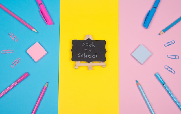 School supplies and a blackboard with back to school