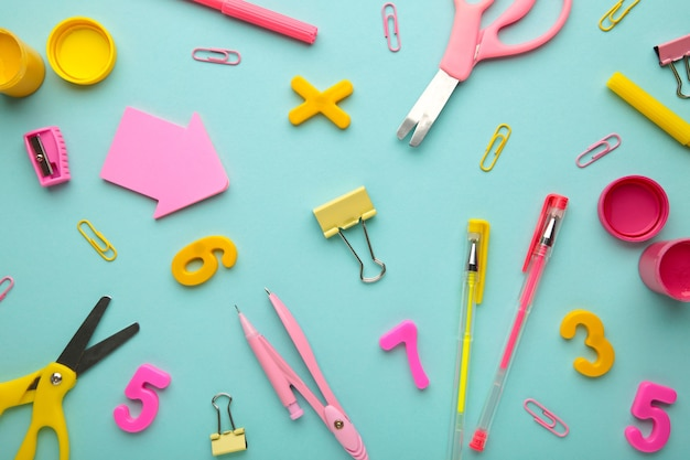 School supplies on blue background. back to school concept.