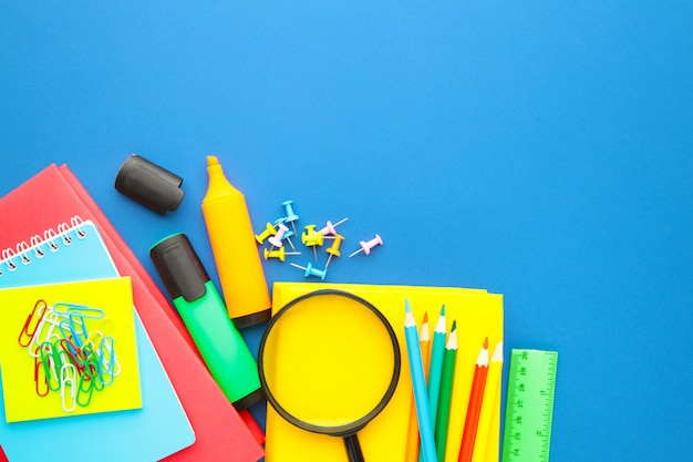 School supplies on blue background. back to school. flat lay.