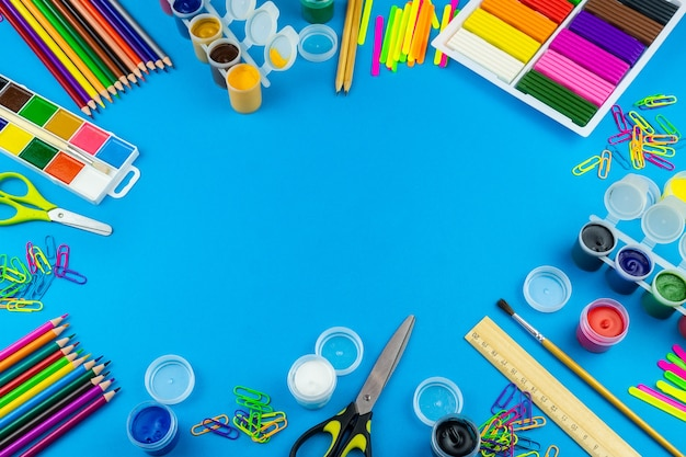 School supplies on a blue background