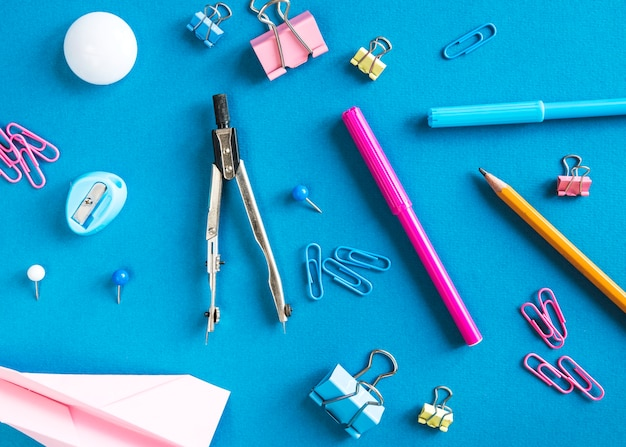 School supplies on blue surface