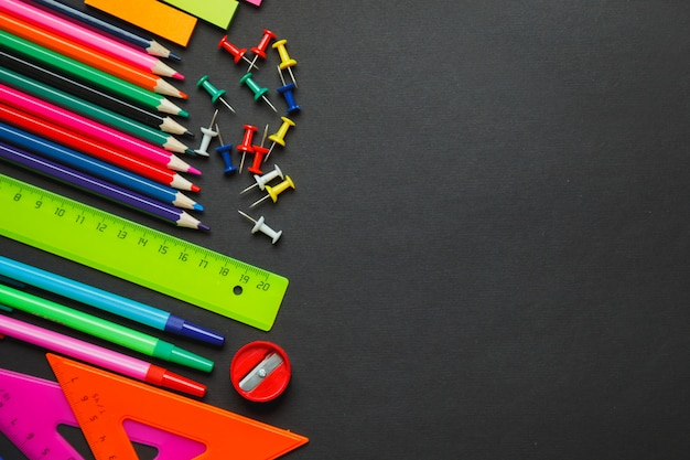 School supplies border on a chalkboard background