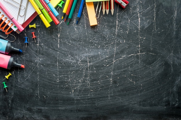 School supplies on a chalkboard background. free space. border
