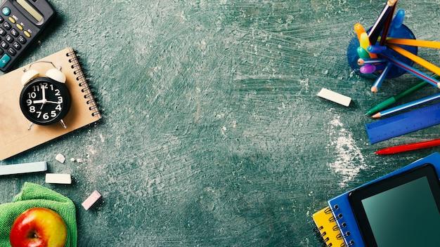 School supplies on a chalkboard