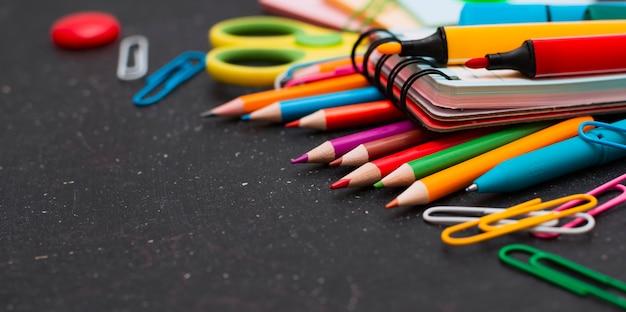School supplies on chalkboard.