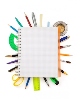 School supplies and checked notebook  on white