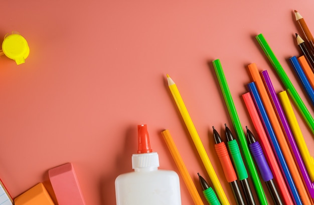 School supplies ,colored pencils top border on pink