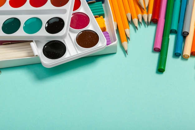 School supplies at colorful background texture