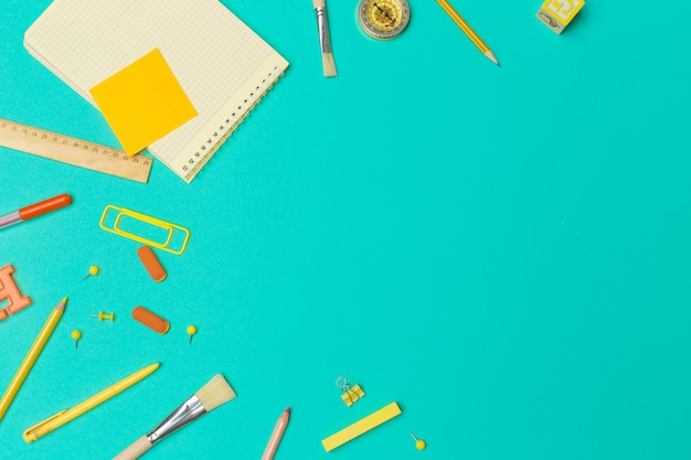 School supplies at colorful paper background