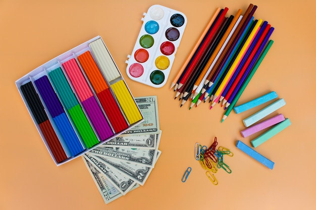 School supplies and dollars, concept is to buy stationery objects.
