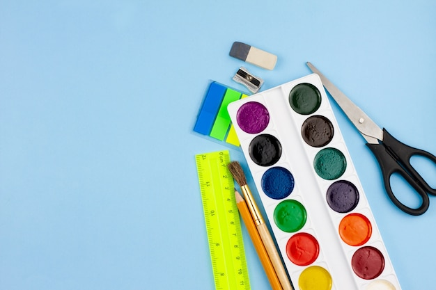 School supplies for education on a blue background.