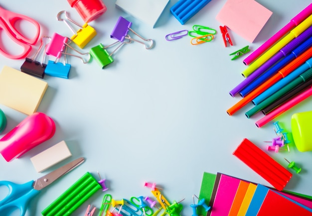 School supplies frame on the light background.