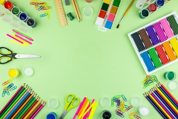 School supplies on a green background