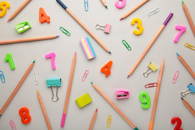 School supplies on grey background. back to school concept.