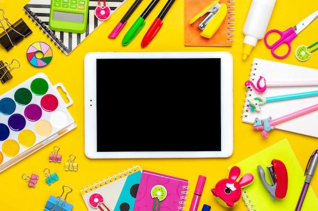 School supplies isolated on yellow