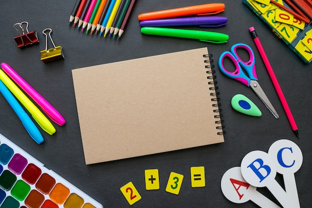 School supplies mockup on blackboard background with copyspace