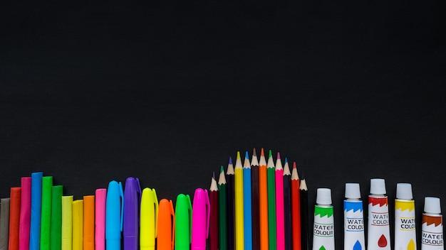 School supplies mockup on blackboard background with copyspace