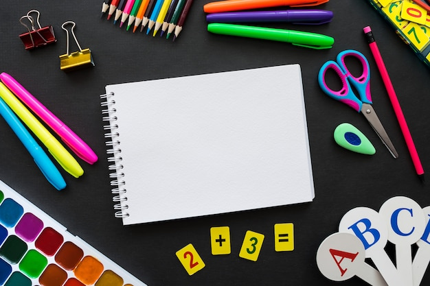 School supplies mockup on blackboard background