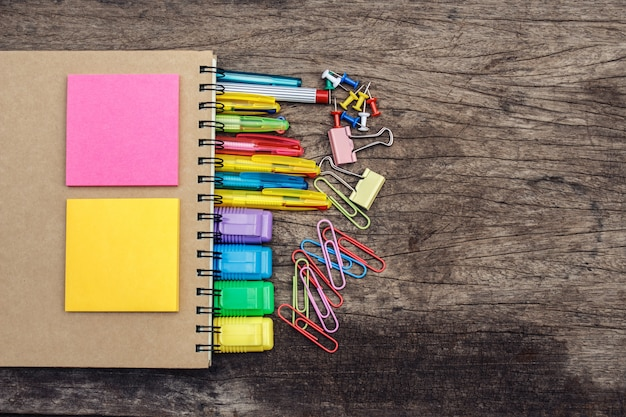School supplies on old wooden background